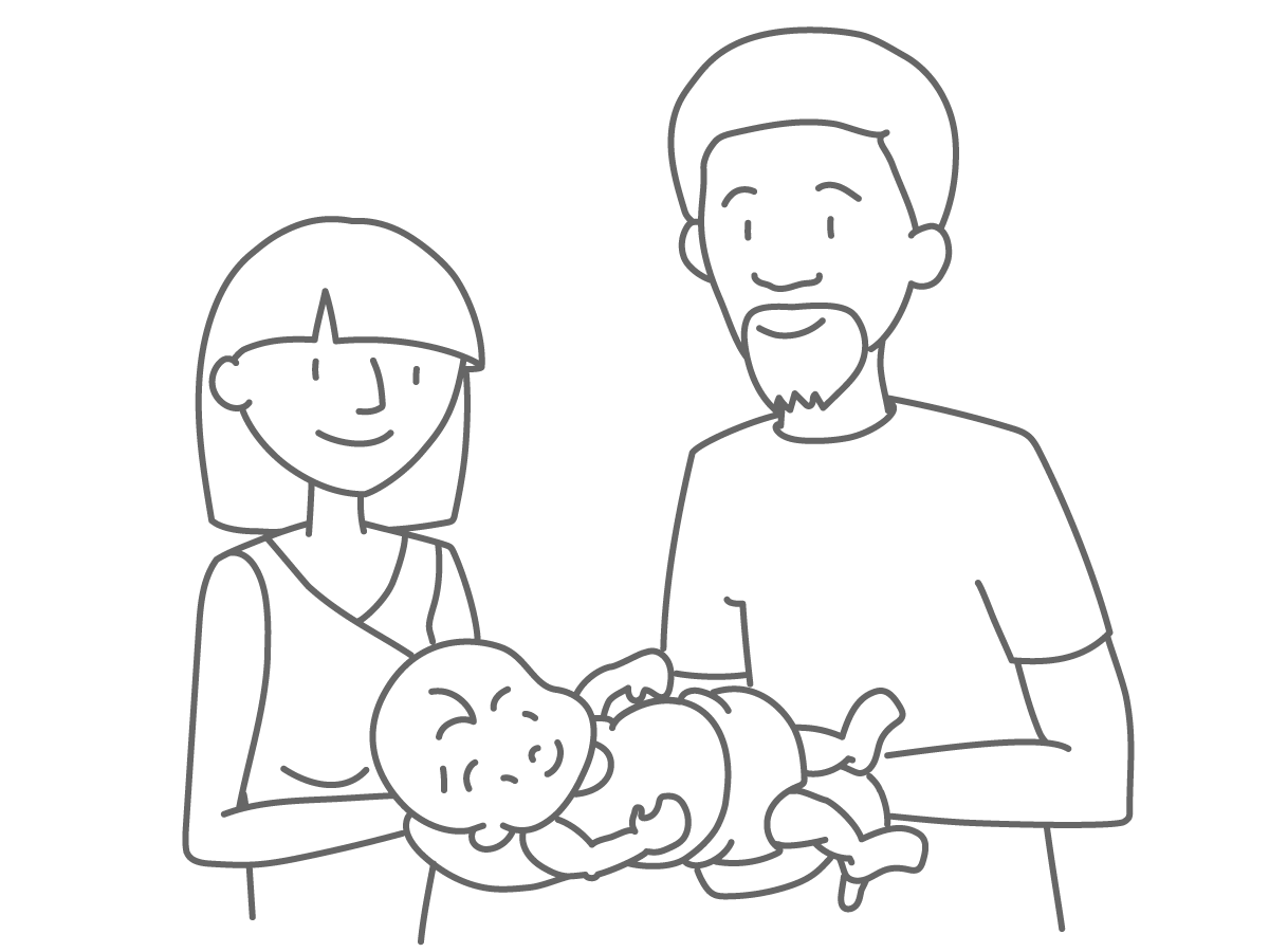 Two new parents holding a baby.
