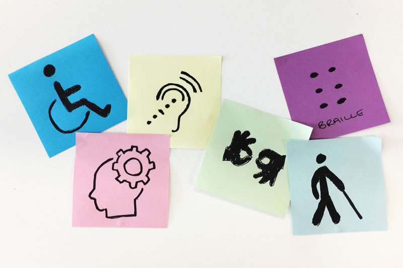 Post-it notes with graphic representations of different disabilities.