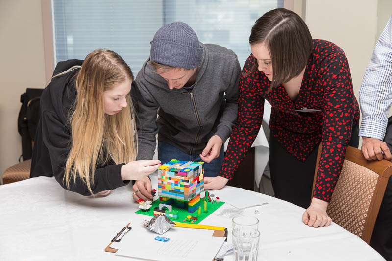 ICT apprentices, cadets and grads build models out of lego at this year's networking day.