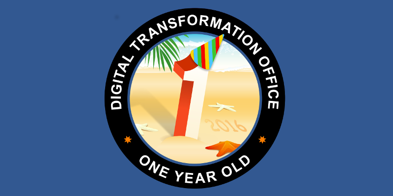 The number 1 on the beach with a party hat with the words Digital Transformation Office One Year Old.