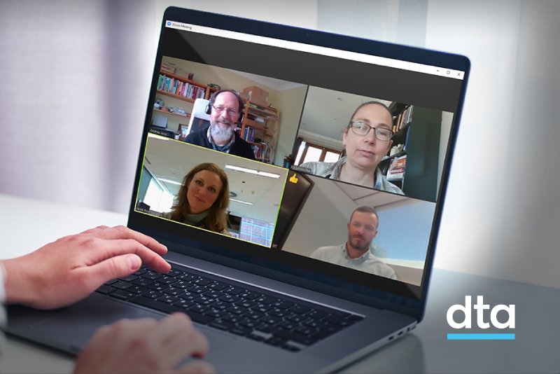 Team in an online meeting on a laptop