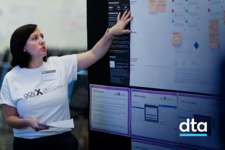 A DTA staff member points to a journey map.