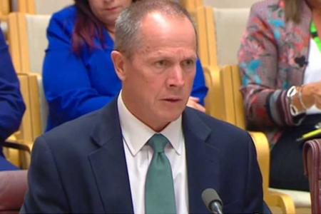 Gavin Slater delivering the opening statement at Senate Estimates.