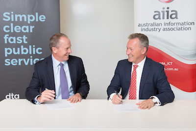 Gavin Slater, CEO of the DTA and Rob Fitzpatrick, CEO of the AIIA signing the MoU.